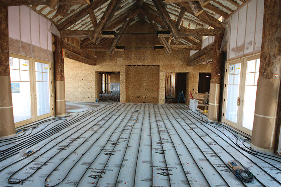 Large room in a house under construction with heated floor before concrete