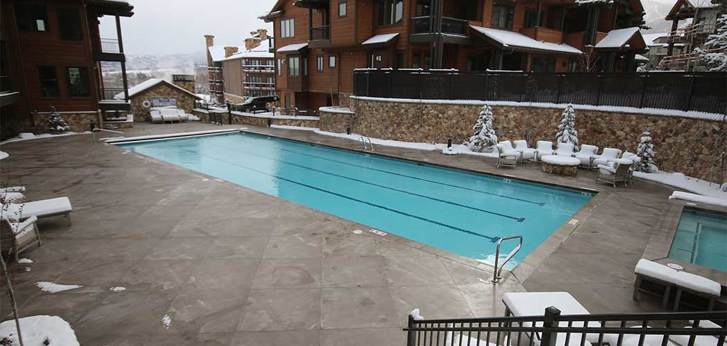 Outdoor pool area of a house with snowmelt system installed.