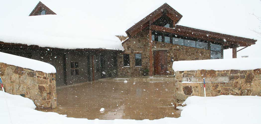 Nice Home in Snow Storm with snowmelt system installed in the driveway.